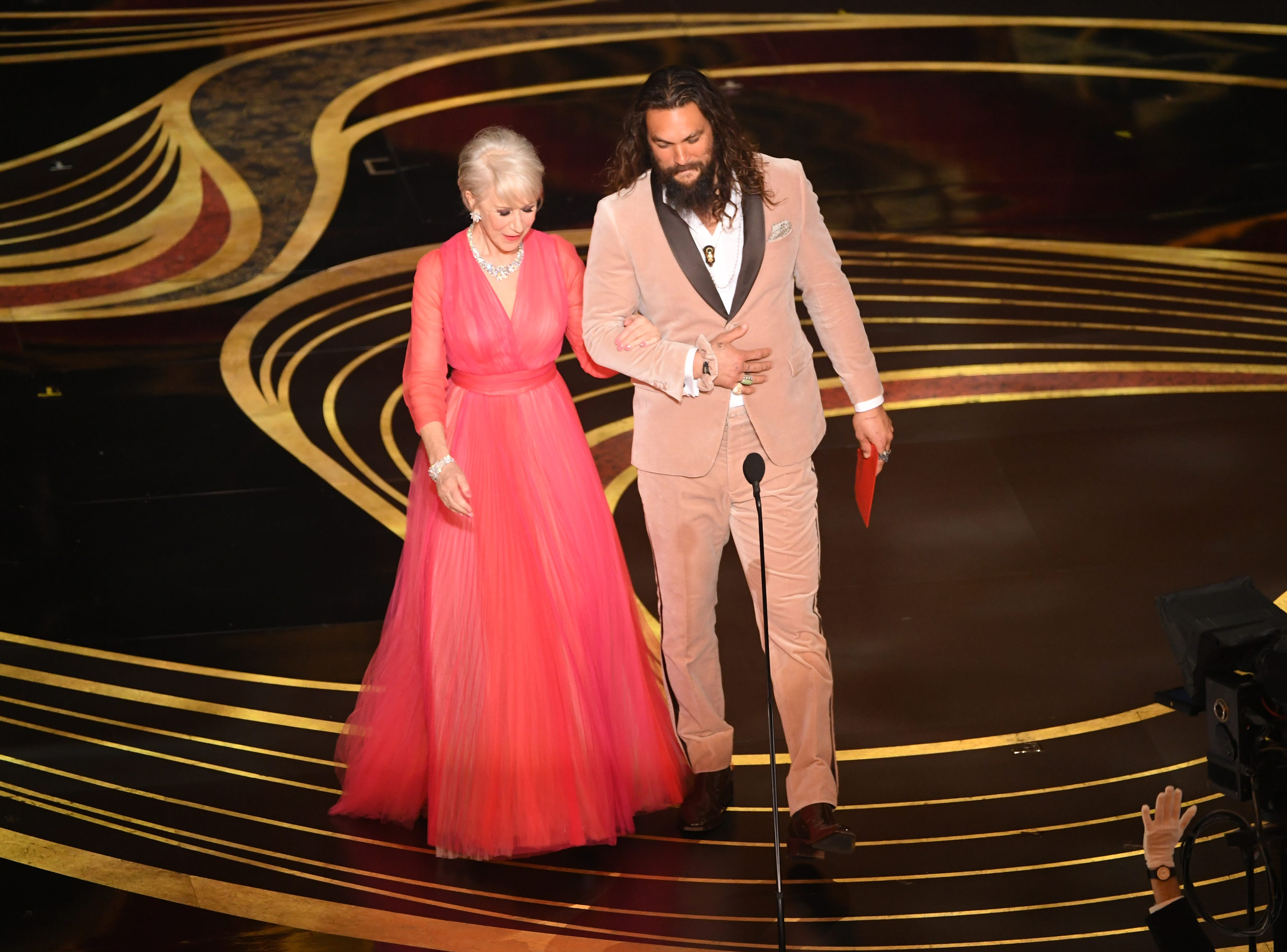Helen Mirren and Jason Momoa walk onstage during the 91st Annual Academy Awards at Dolby Theatre on February 24, 2019 in Hollywood, California.