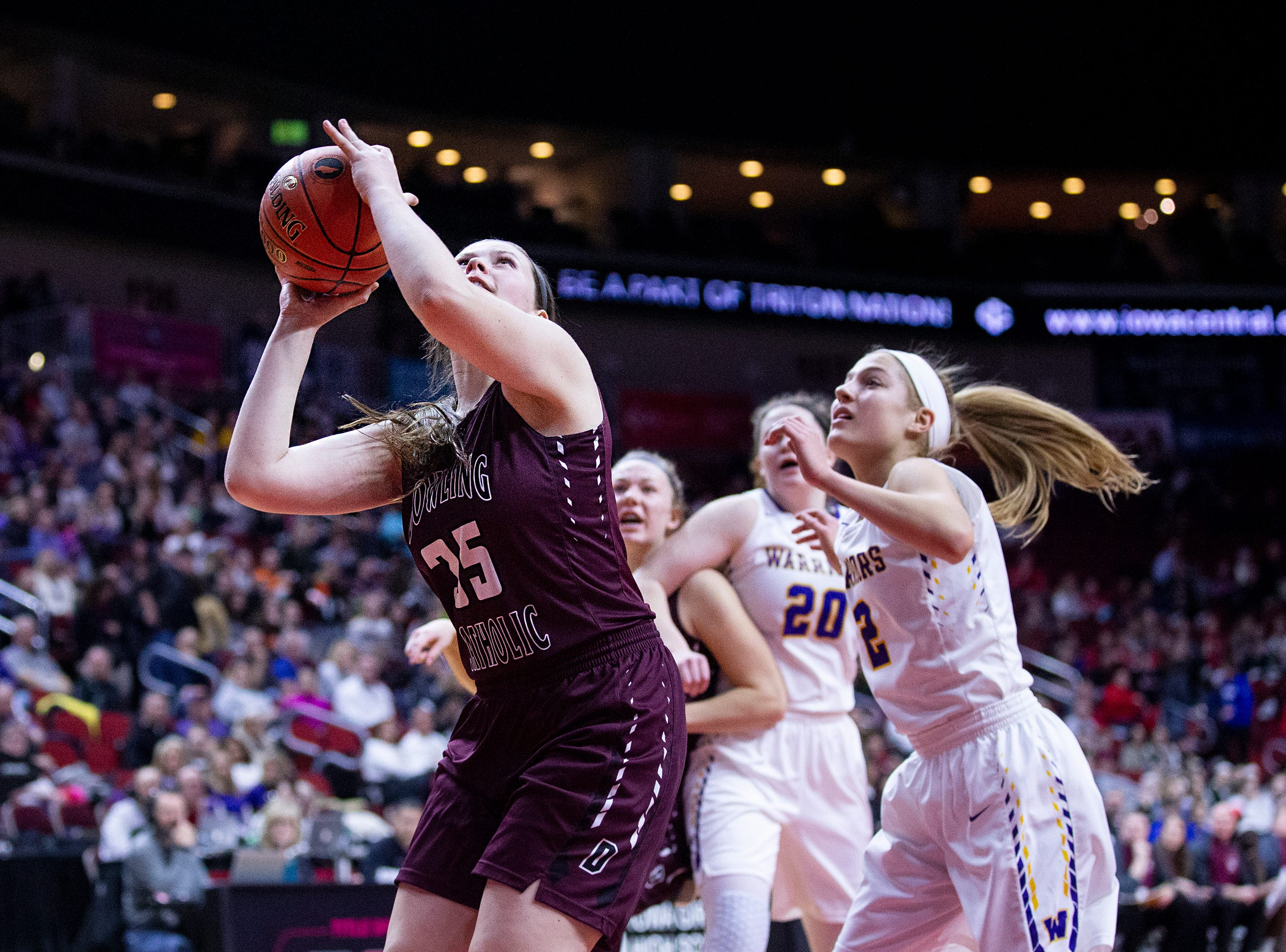 Dowling's Jacey Koethe shoots the ball during the Class 5A Iowa girls' state basketball tournament quarterfinal between Dowling Catholic and Waukee on Monday, Feb. 25, 2019, in Wells Fargo Arena.