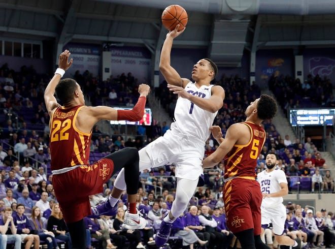 TCU guard Desmond Bane (1) goes up for a shot in the second half of an NCAA college basketball game in Fort Worth, Texas, Saturday, Feb. 23, 2019.