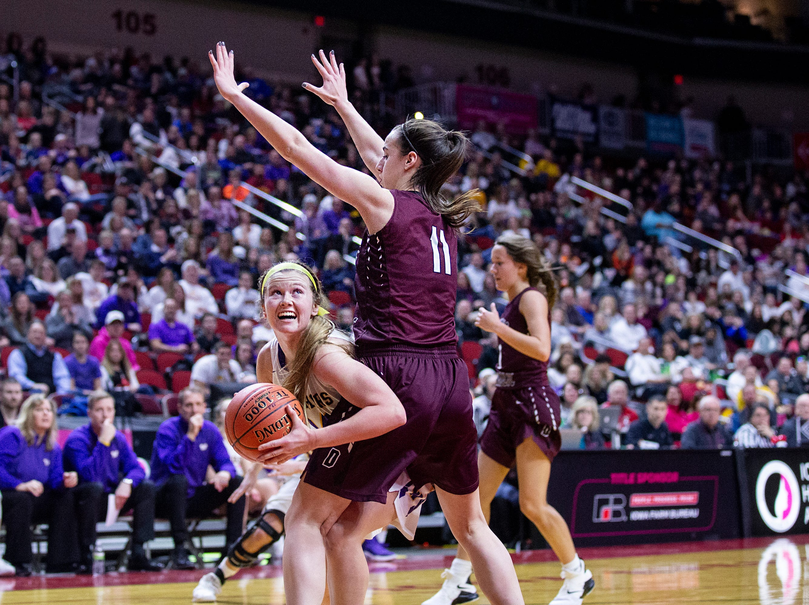 Waukee's Jori Nieman tries to shoot as Dowling's Caitlin Clark defends during the Class 5A Iowa girls' state basketball tournament quarterfinal between Dowling Catholic and Waukee on Monday, Feb. 25, 2019, in Wells Fargo Arena.
