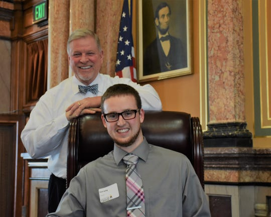 Simpson College student Nick Laning met with state Rep. Scott Ourth on Volunteer Iowa Day at the Capitol to discuss the importance of volunteerism.