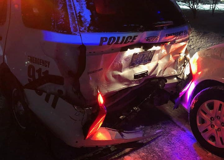 An Altoona police vehicle was damaged after being hit by a passing vehicle while it was stopped to assist a motorist.