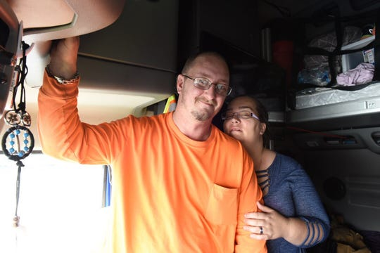 Jason Fincher, 37, and his wife, Christina Mull, 39, both of San Antonio, pose for a picture on Monday, Feb. 25, 2019, inside Fincher's semi truck. The couple has been stranded in central Iowa since Saturday evening as they wait for northbound Interstate 35 to re-open so they can deliver a shipment to St. Paul, Minnesota.