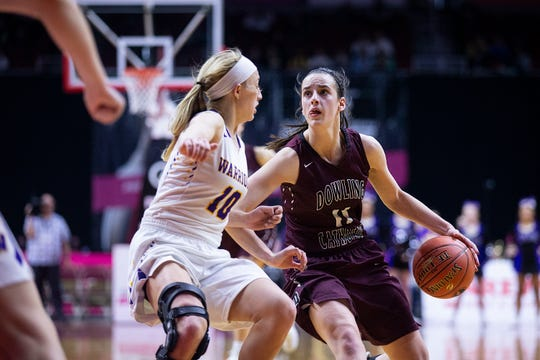 Dowling's Caitlin Clark brings the ball down the court during the Class 5A Iowa girls' state basketball tournament quarterfinal between Dowling Catholic and Waukee on Monday, Feb. 25, 2019, in Wells Fargo Arena.