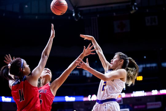 Johnston's Maya McDermott shoots the ball during the Class 5A Iowa girls' state basketball tournament quarterfinal between Johnston and Urbandale on Monday, Feb. 25, 2019, in Wells Fargo Arena.