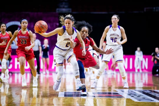 Johnston's Maya McDermott and Urbandale's DeeDee Pryor reach for the ball during the Class 5A Iowa girls' state basketball tournament quarterfinal between Johnston and Urbandale on Monday, Feb. 25, 2019, in Wells Fargo Arena.