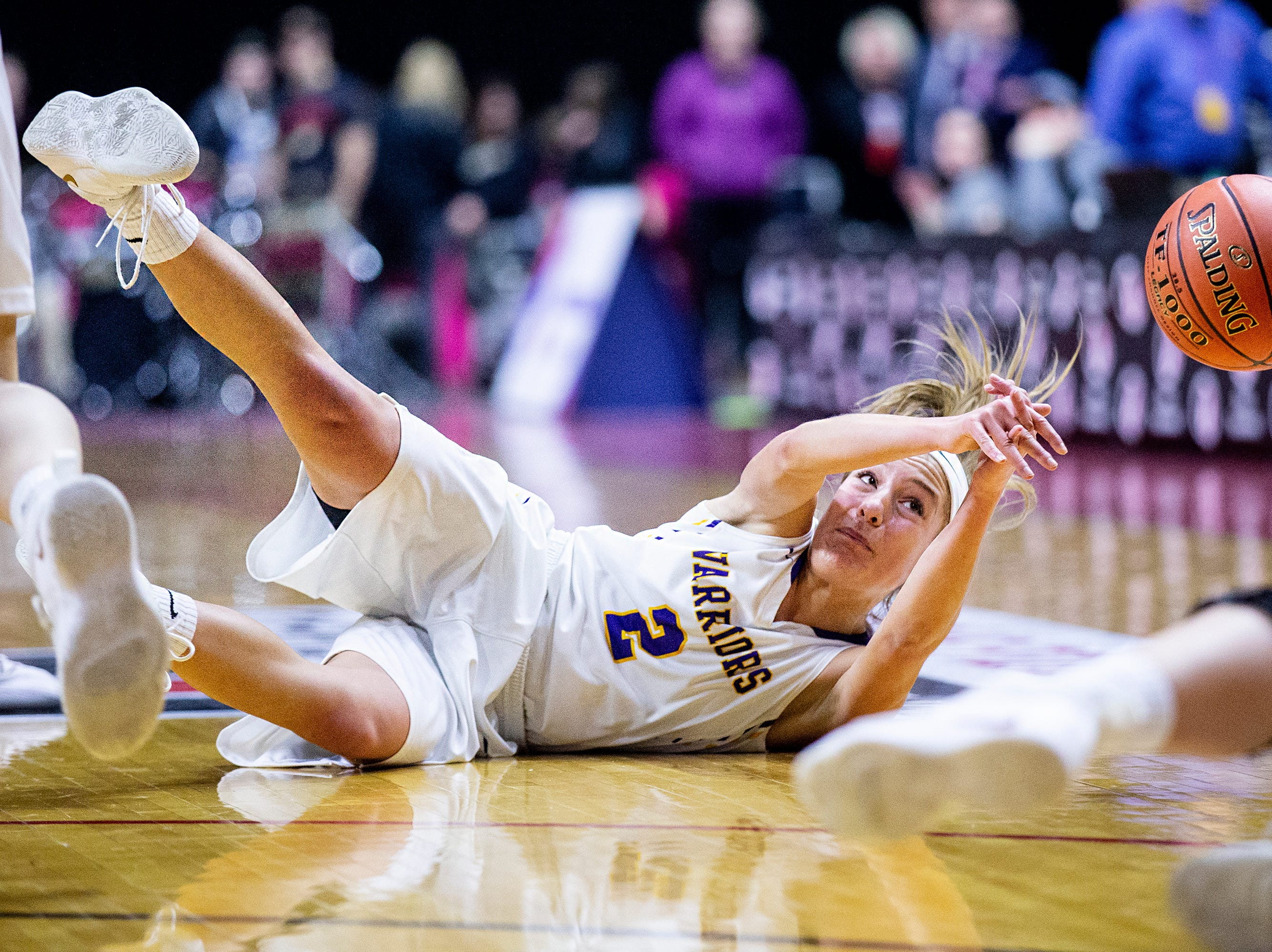 Waukee's Lindsey Kelderman tries to hold on to the ball during the Class 5A Iowa girls' state basketball tournament quarterfinal between Dowling Catholic and Waukee on Monday, Feb. 25, 2019, in Wells Fargo Arena.