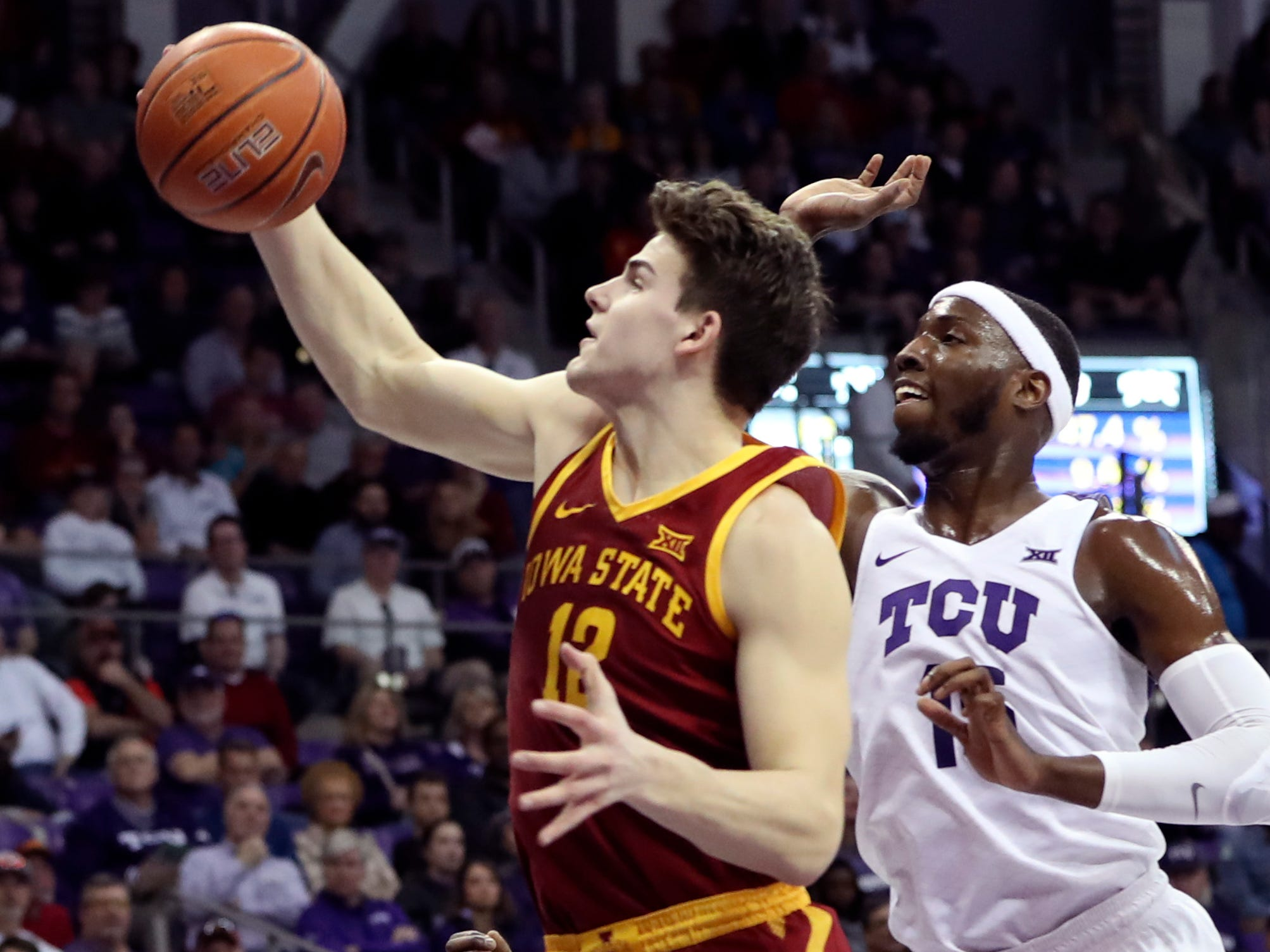 Feb 23, 2019; Fort Worth, TX, USA; Iowa State Cyclones forward Michael Jacobson (12) grabs a rebound past TCU Horned Frogs forward JD Miller (15) during the first half at Ed and Rae Schollmaier Arena.