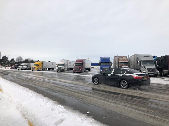 Semis are lined up in the Prairie Meadows Casino parking lot Monday, Feb. 25, 2019. Drivers waiting for Interstate 35 to reopen north of Ames were asked to pull of at the casino.
