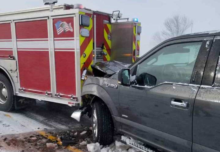 An Ankeny fire truck was struck by a passing pickup truck while responding to a crash along Interstate 35 on Sunday. No one was injured.