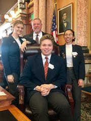 Iowa House of Representatives pages Tyler Juffernbruch of Indianola, front,  Ally Emberton and Elizabeth Lara, both of Carlisle, take a break from their duties for a photo with state Rep. Scott Ourth.