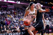 Southeast Polk's Maggie McGraw drives to the hoop during the Class 5A Iowa girls' state basketball tournament quarterfinal between Southeast Polk and Ankeny Centennial on Monday, Feb. 25, 2019, in Wells Fargo Arena.
