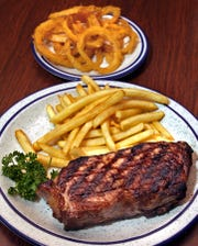 The 16-ounce Yankee's New York strip with fries and onion rings served at Jesse's Embers.