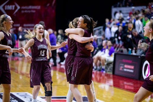 Dowling's Caitlin Clark and Dowling's Grace Gaber his after winning the Class 5A Iowa girls' state basketball tournament quarterfinal between Dowling Catholic and Waukee on Monday, Feb. 25, 2019, in Wells Fargo Arena.