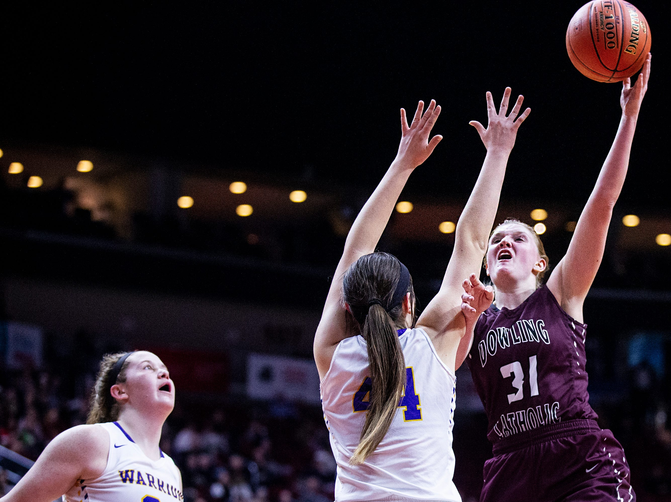 Dowling's Grace Gaber shoots the ball during the Class 5A Iowa girls' state basketball tournament quarterfinal between Dowling Catholic and Waukee on Monday, Feb. 25, 2019, in Wells Fargo Arena.