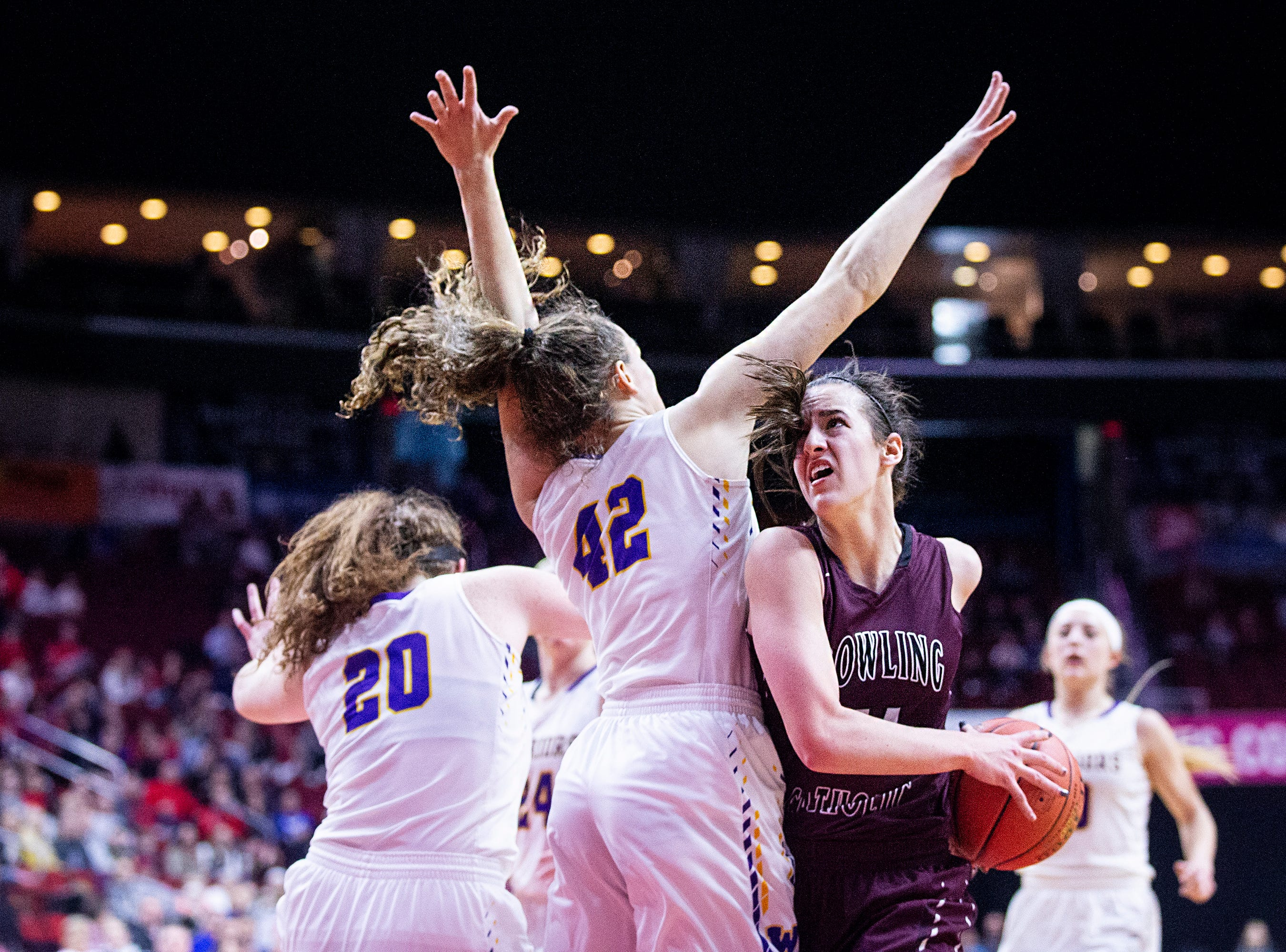 Dowling's Caitlin Clark drives to the hoop during the Class 5A Iowa girls' state basketball tournament quarterfinal between Dowling Catholic and Waukee on Monday, Feb. 25, 2019, in Wells Fargo Arena.