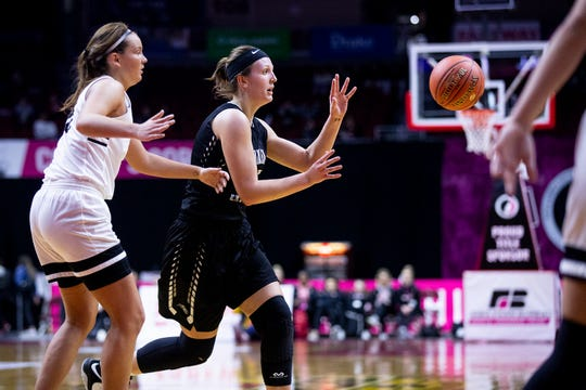 Ankeny Centennial's Rachel Schon passes the ball during the Class 5A Iowa girls' state basketball tournament quarterfinal between Southeast Polk and Ankeny Centennial on Monday, Feb. 25, 2019, in Wells Fargo Arena.