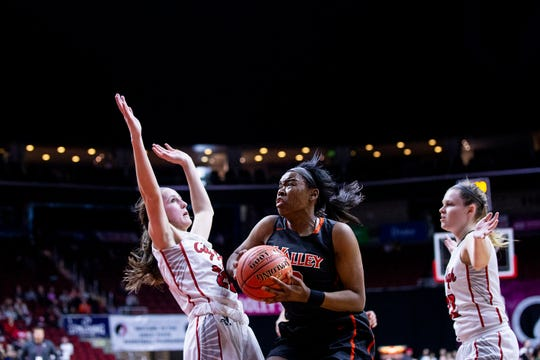 West Des Moines Valley's Zoe Young shoots the ball during the Class 5A Iowa girls' state basketball tournament quarterfinal between Iowa City City High and West Des Moines Valley on Monday, Feb. 25, 2019, in Wells Fargo Arena.
