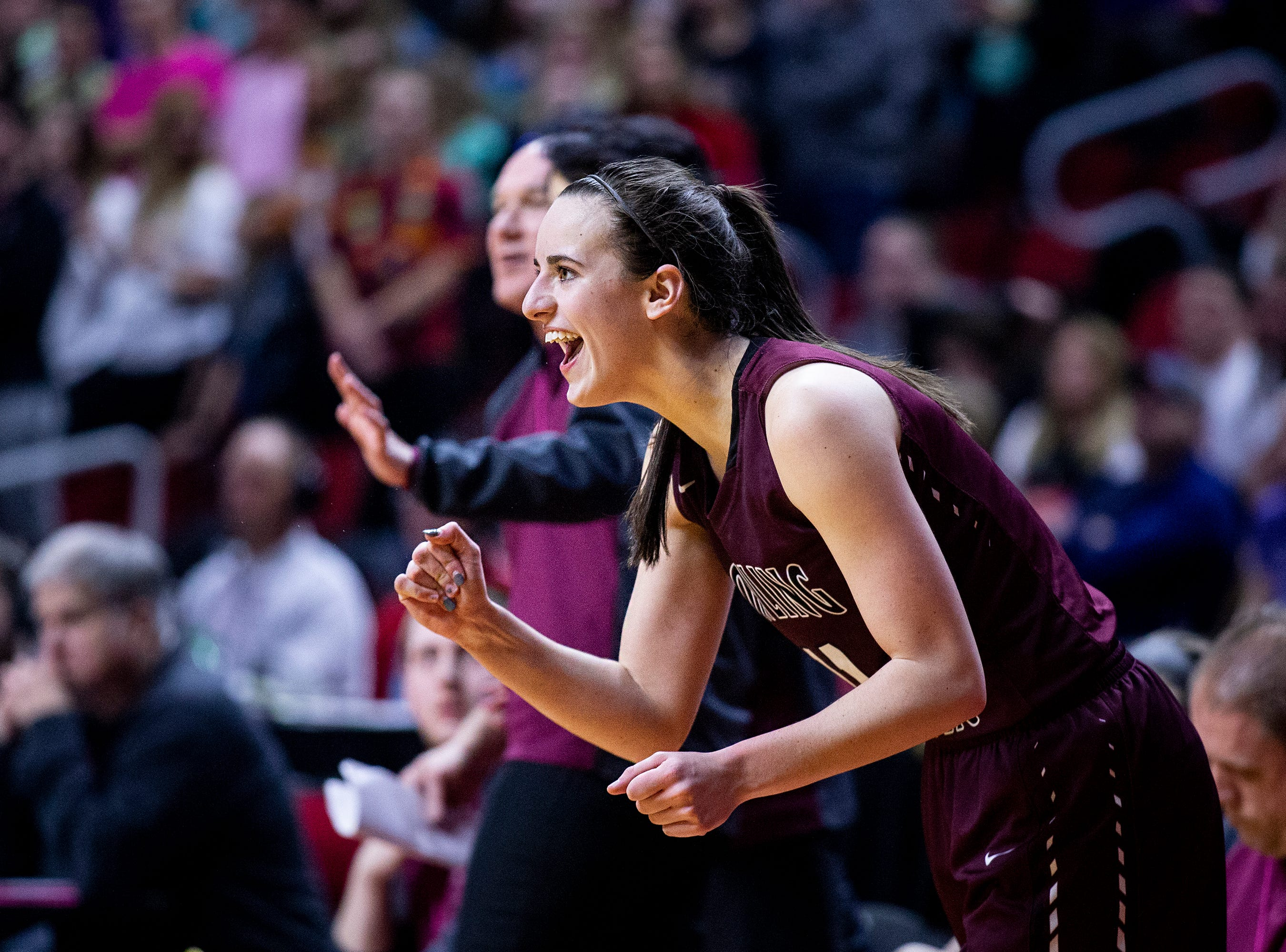 Dowling's Caitlin Clark cheers from the bench after fouling out in the third overtime during the Class 5A Iowa girls' state basketball tournament quarterfinal between Dowling Catholic and Waukee on Monday, Feb. 25, 2019, in Wells Fargo Arena.