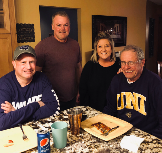 Tim Foreman, Todd Janes, Davey Janes and Curt Forman enjoy a meal together on the Janes farm near Buckeye. The Janeses were part of an effort to rescue the Foremans from a ditch off U.S. Highway 20 during the weekend blizzard.