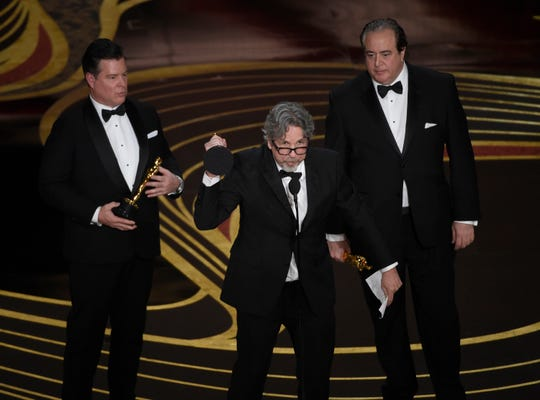"Brian Hayes Currie, from left, Peter Farrelly and Nick Vallelonga accept the award for best original screenplay for ""Green Book"" at the Oscars on Sunday, Feb. 24, 2019, at the Dolby Theatre in Los Angeles."