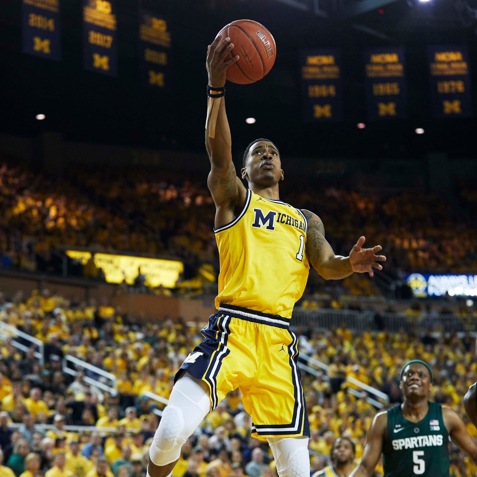 Michigan's Charles Matthews out with ankle injury against Nebraska