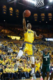 Michigan's Charles Matthews shoots in the first half against Michigan State at Crisler Center in Ann Arbor, Sunday, Feb. 24, 2019.