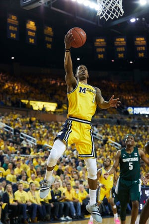 Michigan's Charles Matthews shoots in the first half against Michigan State at Crisler Center in Ann Arbor on Feb. 24, 2019.