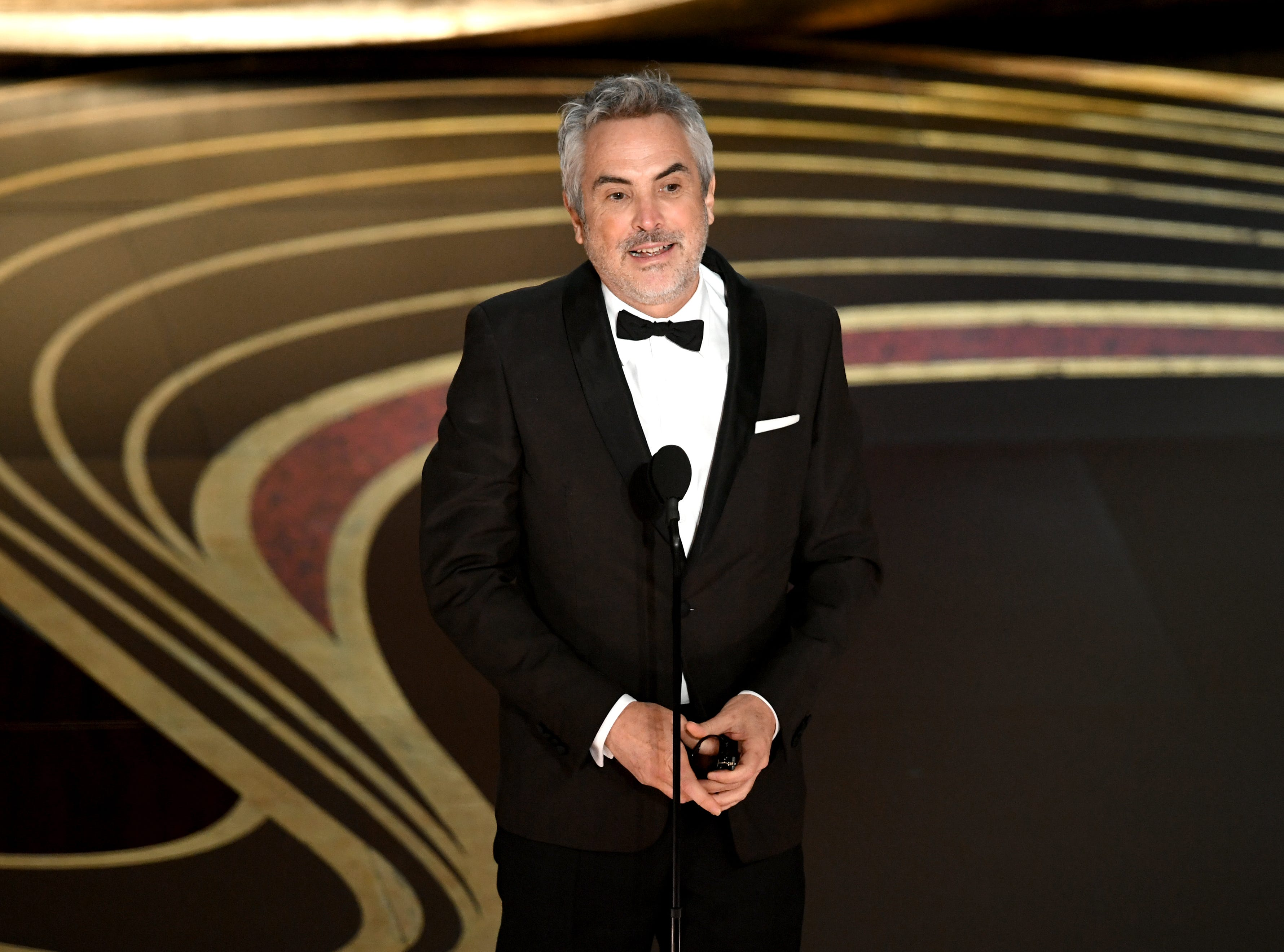 Alfonso Cuaron accepts the Best Director award for 'Roma' onstage during the 91st Annual Academy Awards.