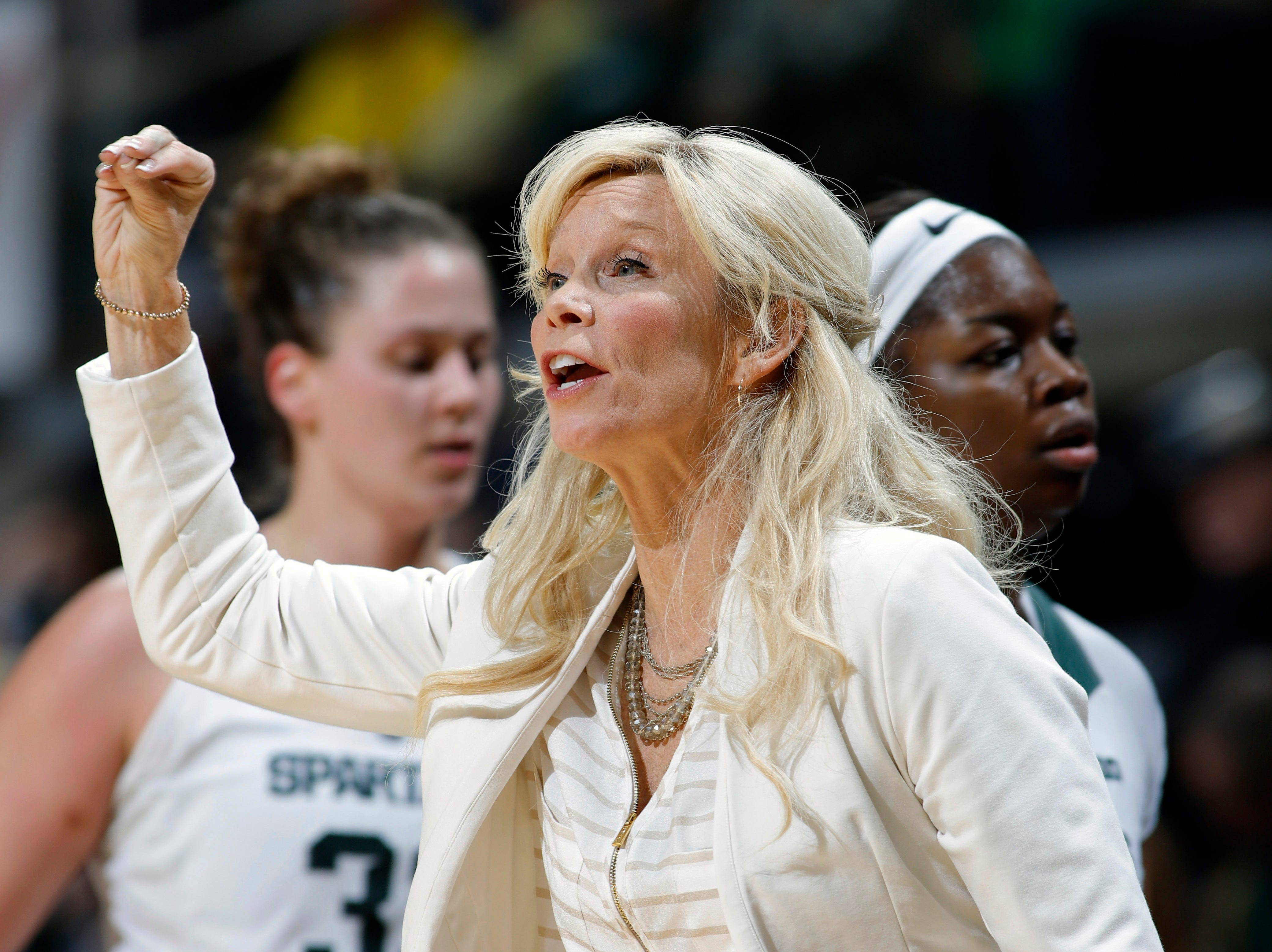 Michigan State coach Suzy Merchant gives instructions against Michigan during the third quarter.