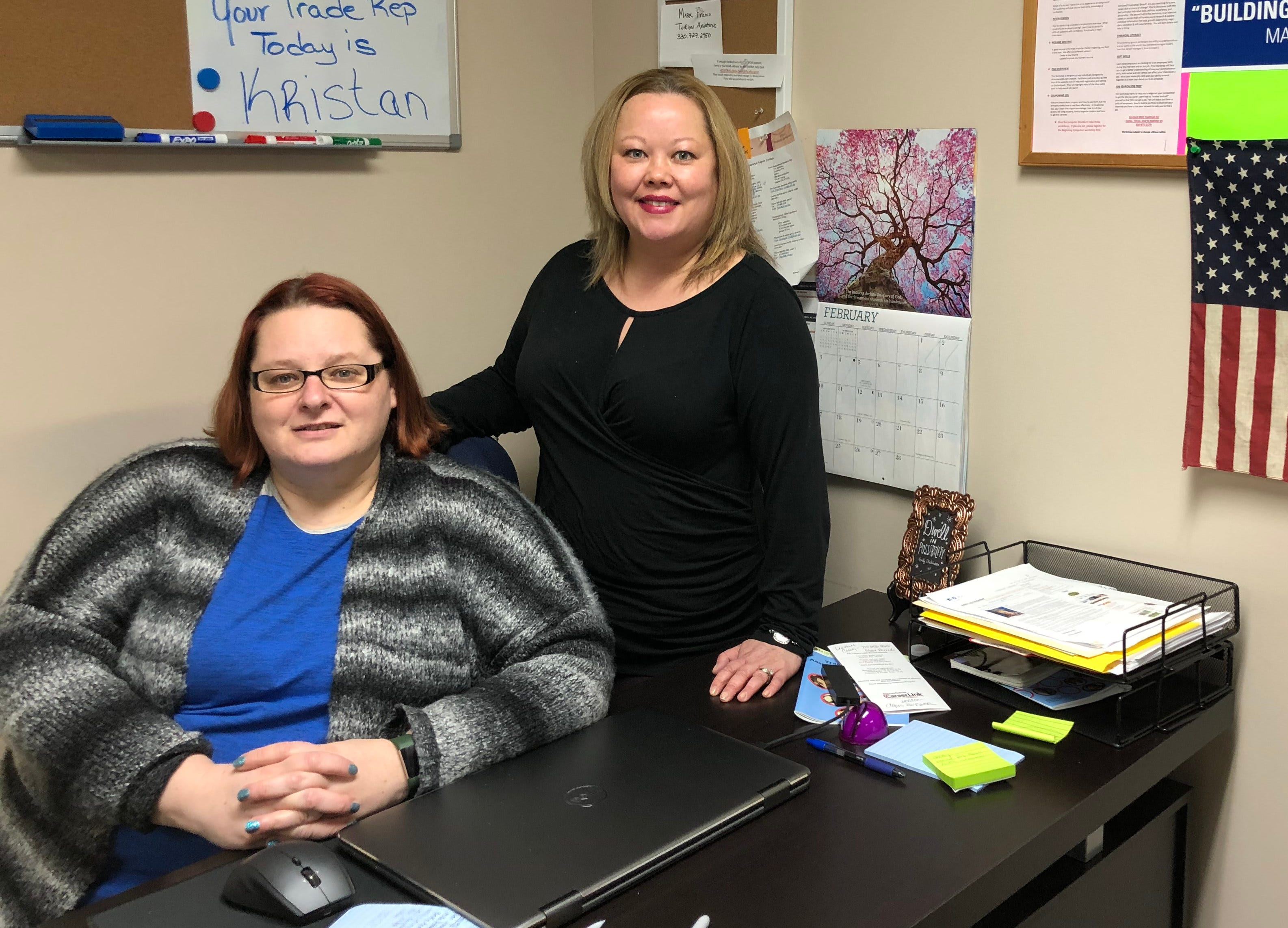 Laid off General Motors Co. assembly workers Trisha Amato and Christina Defelice now help run a worker transition center at UAW Local 1112.