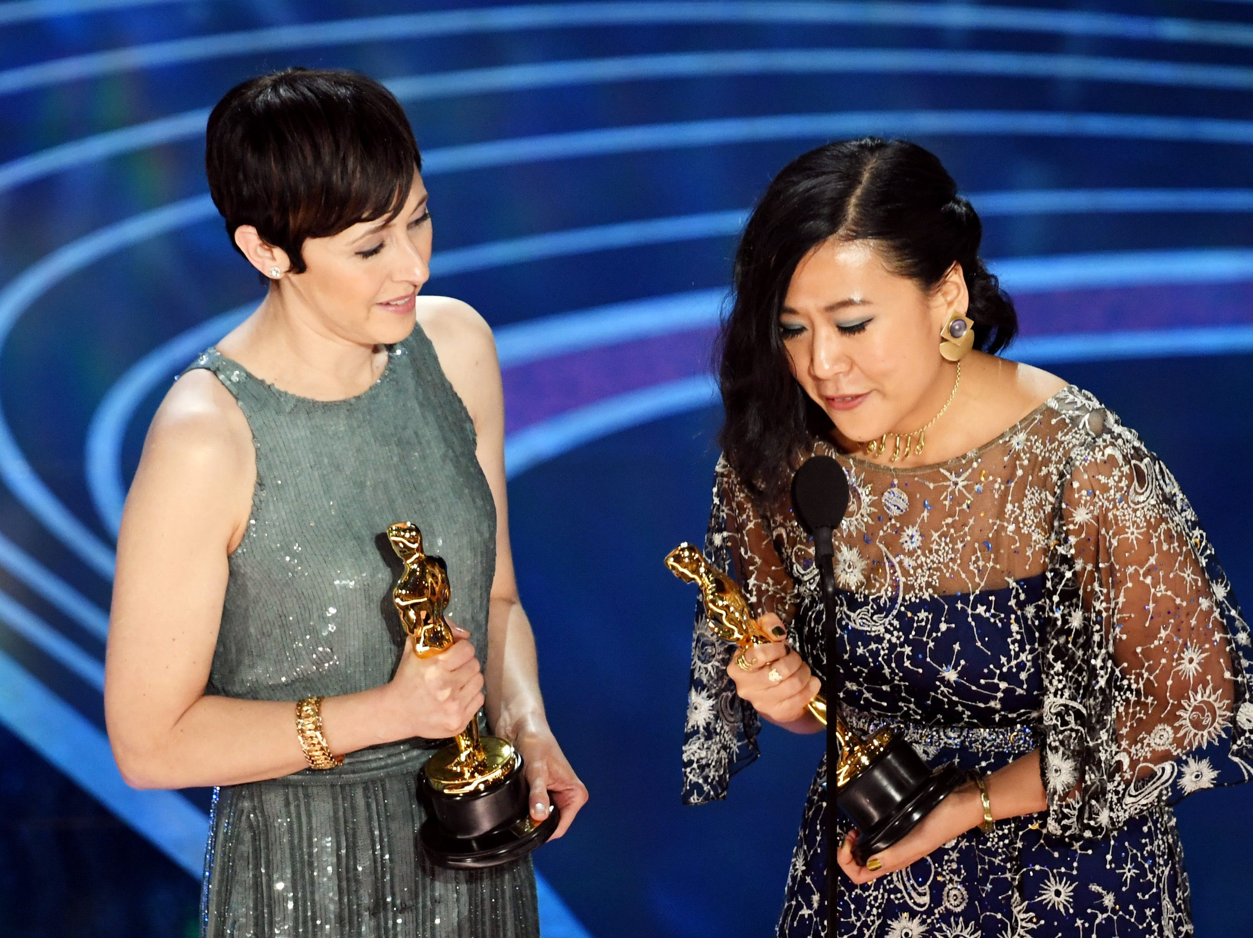 Becky Neiman-Cobb and Domee Shi accept the Short Film (Animated) award for 'Bao' onstage during the 91st Annual Academy Awards.