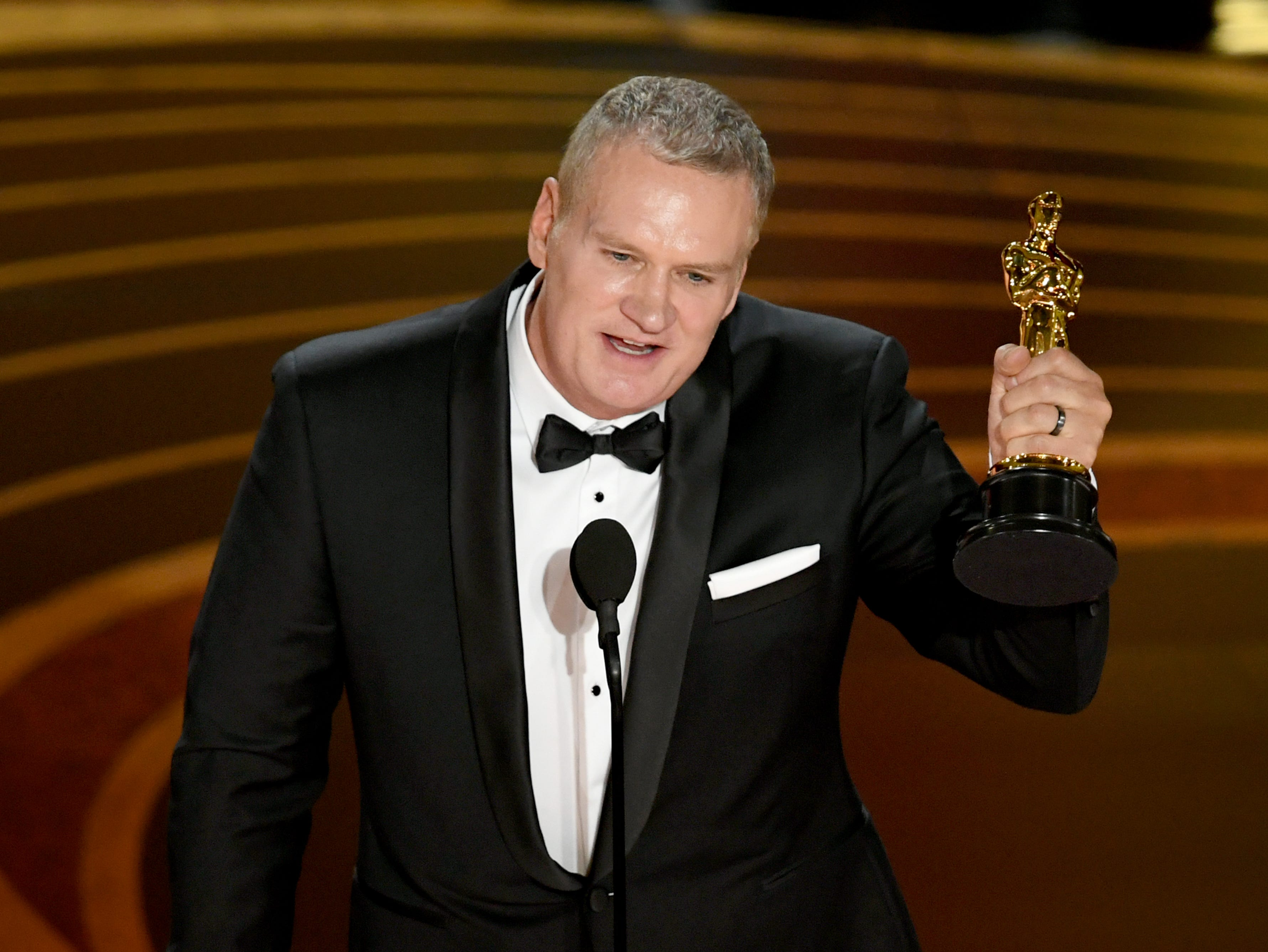 John Ottman accepts the Film Editing award for 'Bohemian Rhapsody' onstage during the 91st Annual Academy Awards.