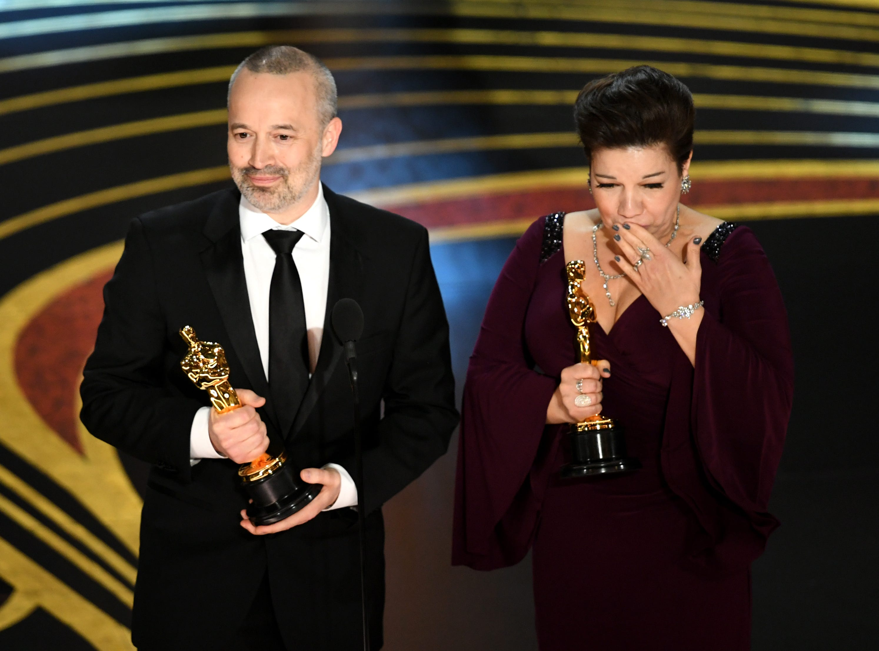 John Warhurst and Nina Hartstone accept the Sound Editing award for 'Bohemian Rhapsody' onstage during the 91st Annual Academy Awards at Dolby Theatre.