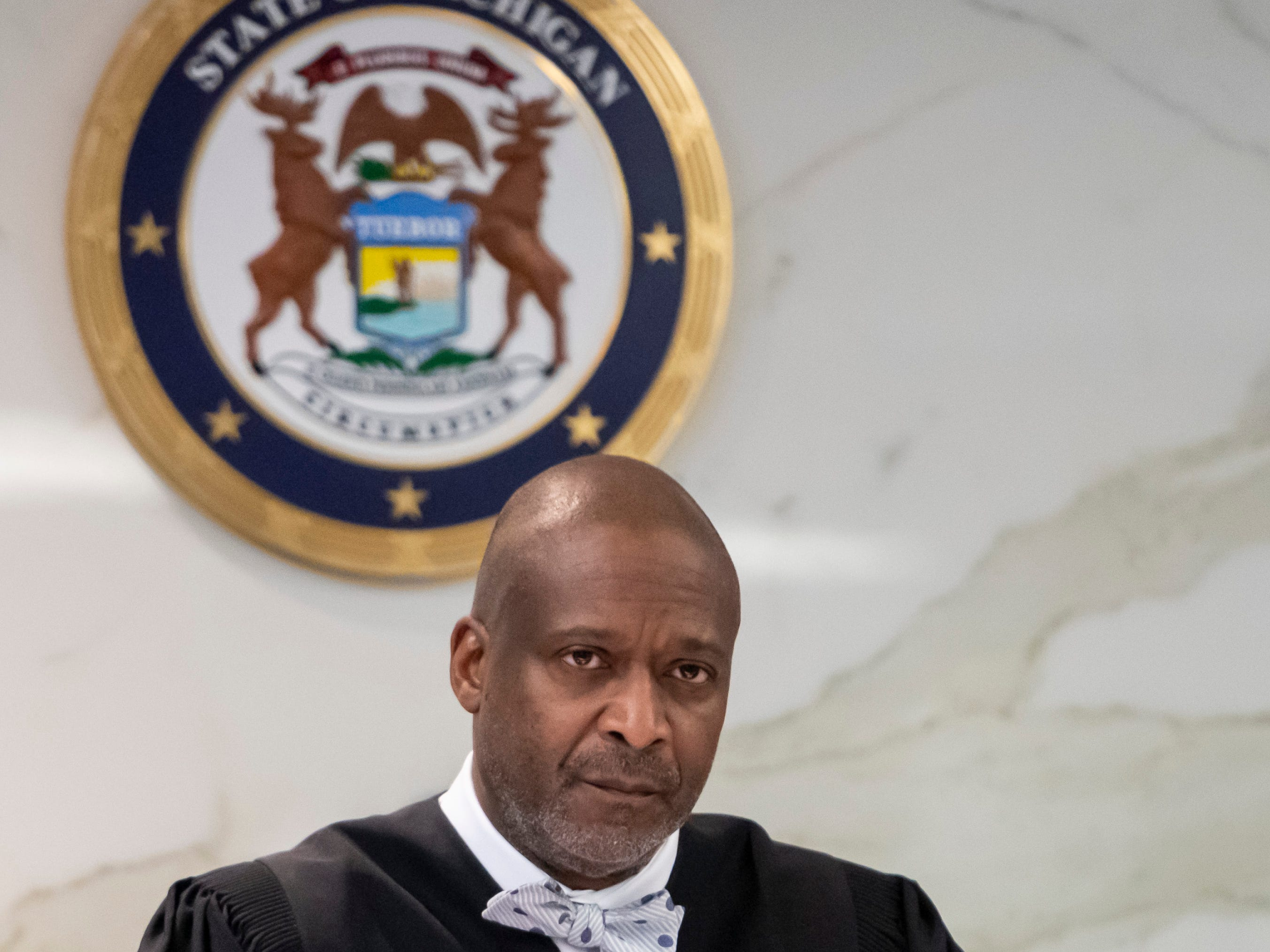 Judge Michael Wagner prepares to start a preliminary hearing for Pastor Albert Weathers in the death of Kelly Stough, at 36th District Court in Detroit, Feb. 25, 2019,
