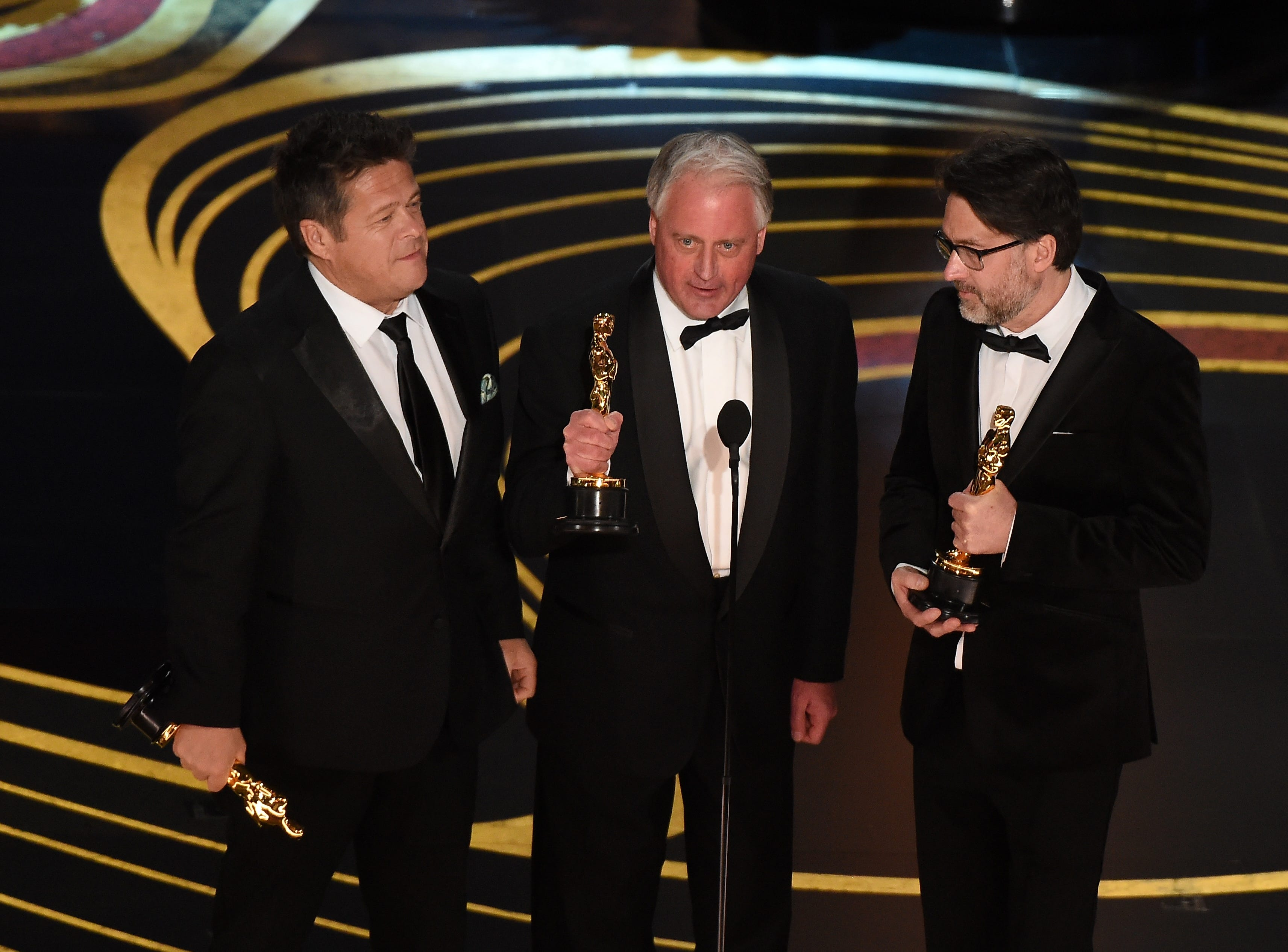 "Best Sound Mixing nominees for ""Bohemian Rhapsody"" Paul Massey, Tim Cavagin and John Casali accepts the award for Best Sound Mixing during the 91st Annual Academy Awards."