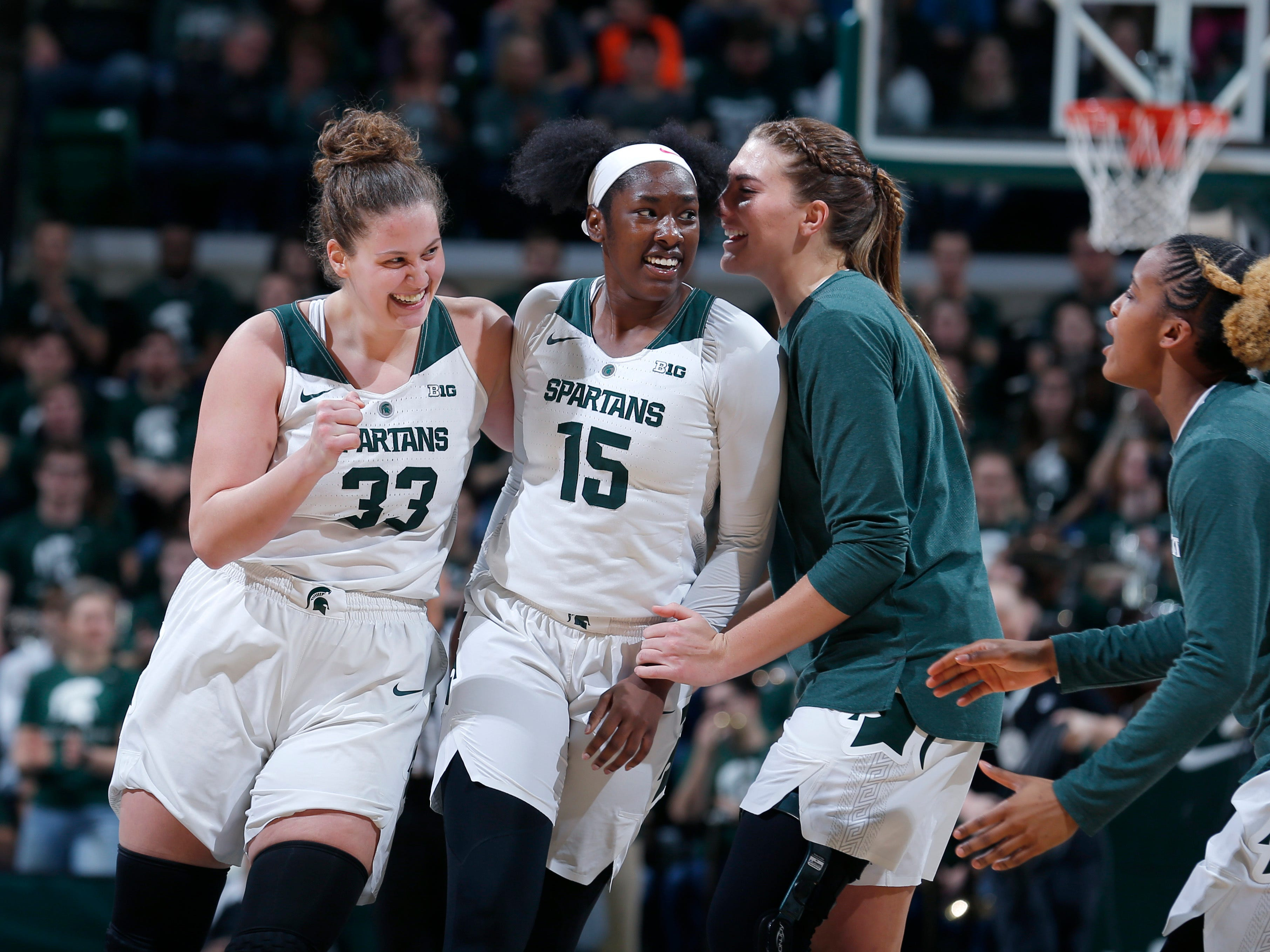 Michigan State's Jenna Allen, from left, Victoria Gaines (15), Kayla Belles and Shay Colley celebrate during the Spartans' 74-64 victory over the Michigan Wolverines in East Lansing,  Sunday, Feb. 24, 2019.