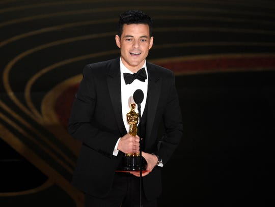 "Rami Malek accepts the award for best performance by an actor in a leading role for ""Bohemian Rhapsody"" at the Oscars on Sunday, Feb. 24, 2019, at the Dolby Theatre in Los Angeles."