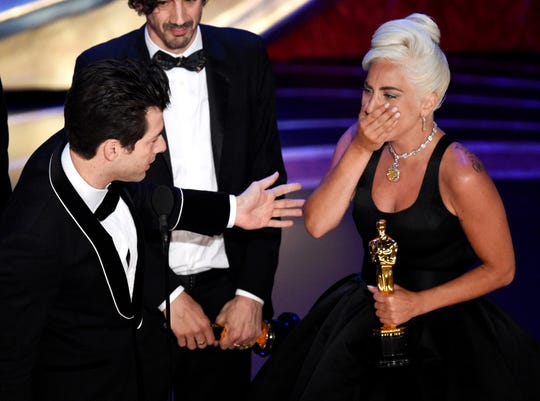 "Mark Ronson, from left, Anthony Rossomando and Lady Gaga accept the award for best original song for ""Shallow"" from ""A Star Is Born"" at the Oscars."