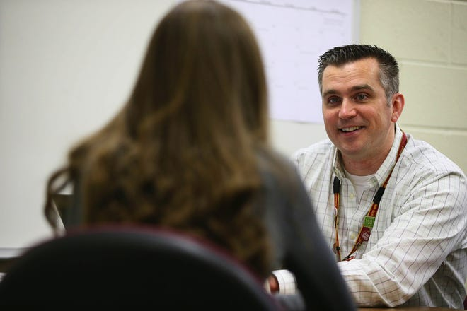 Eric Melton, school counselor and department chair of student services at Schaumburg High School, meets with a student in his office on Feb. 7, 2019. Melton said he has seen a blurring of lines among peer groups. (Stacey Wescott/Chicago Tribune/TNS)