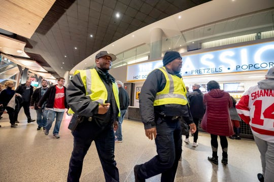 Detroit police officers walk through the concourse level of Little Caesars Arena before the start of a Feb. 20 game between the Detroit Red Wings and the Chicago Blackhawks.