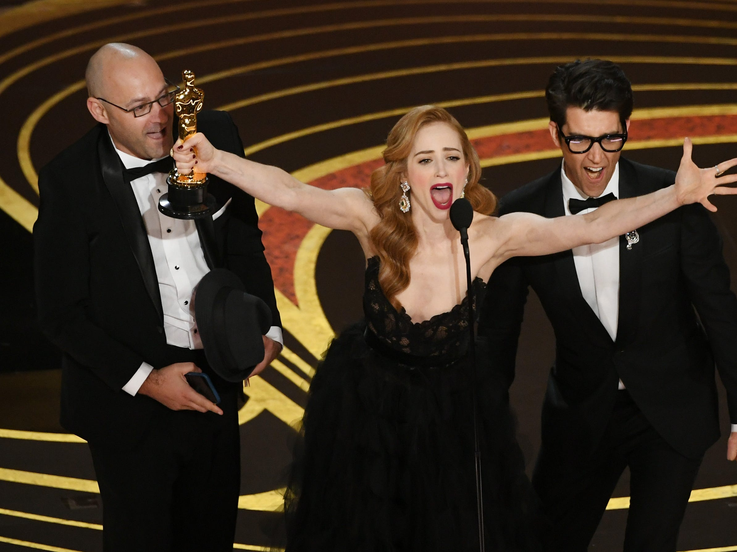 "Jaime Ray Newman and Guy Nattiv accept the Best Live Action Short Film award for ""Skin"" onstage during the 91st Annual Academy Awards."