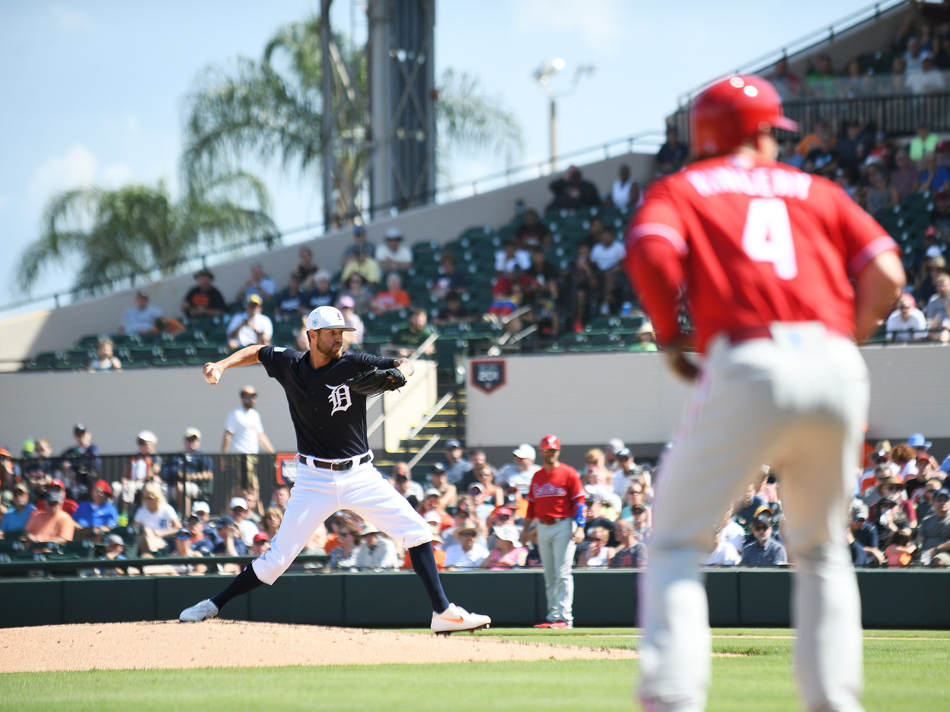 With a man on third, Tigers pitcher Shane Greene works in the third inning.