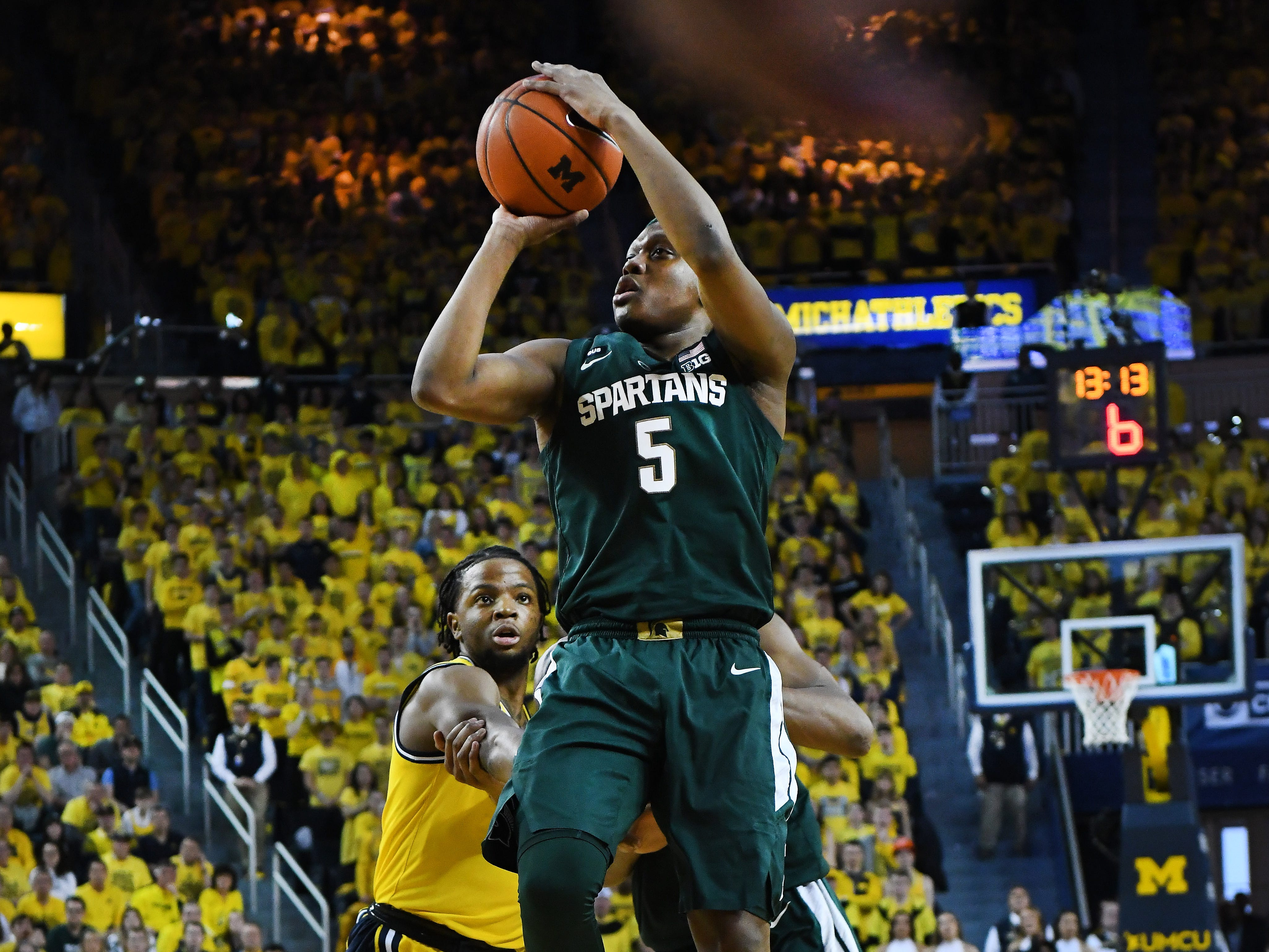 Michigan State's Cassius Winston puts up a shot in the first half.