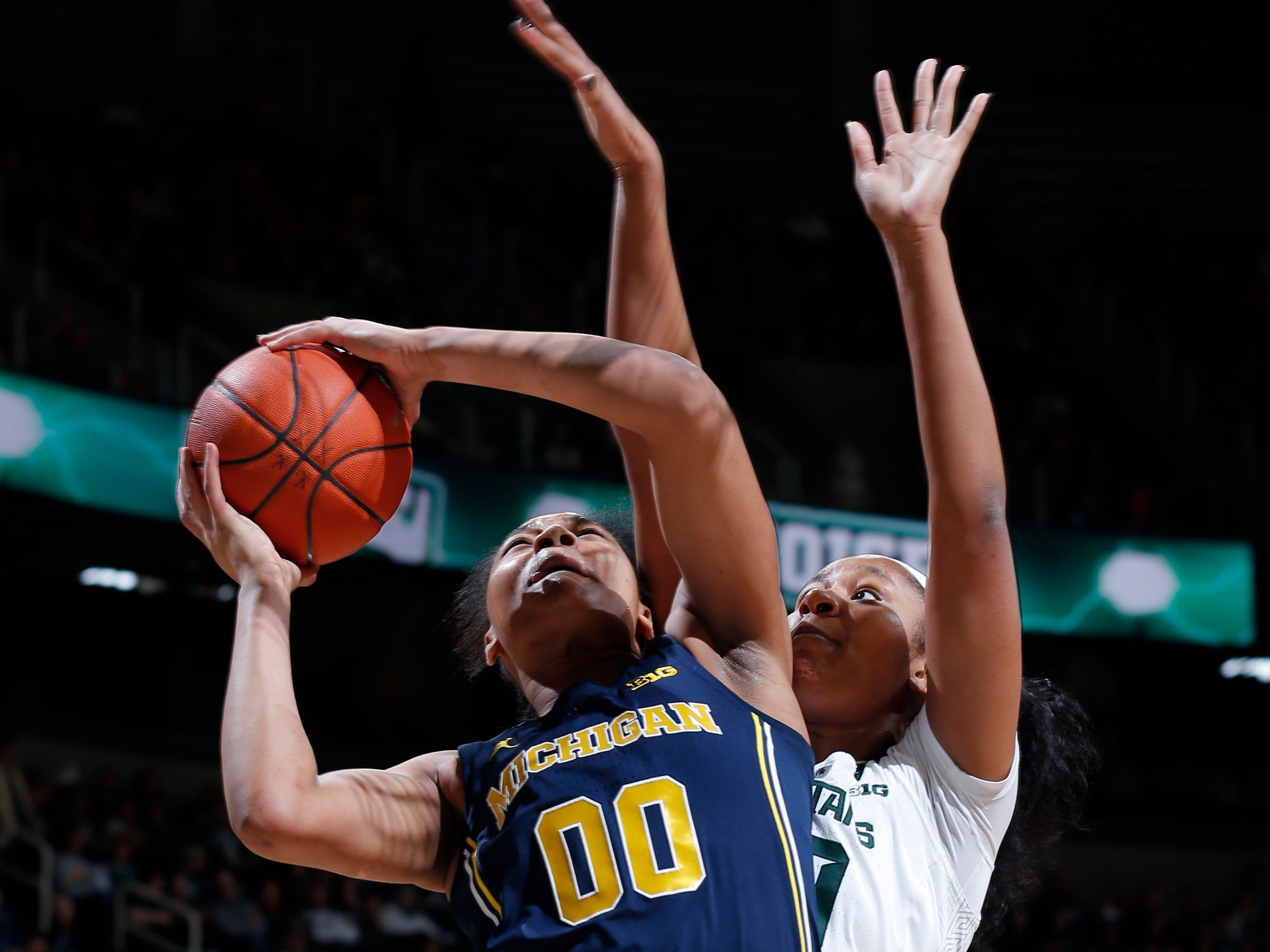 Michigan's Naz Hillman, left, shoots against Michigan State's Sidney Cooks during the first quarter.