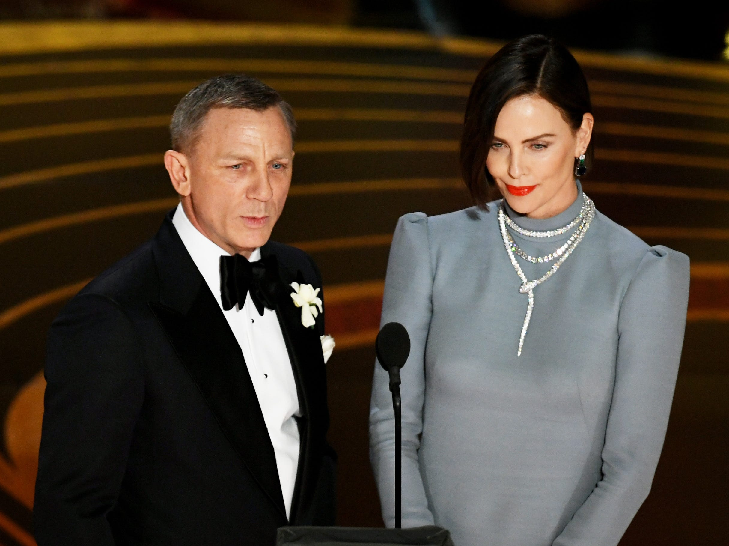 Daniel Craig and Charlize Theron speak onstage during the 91st Annual Academy Awards.