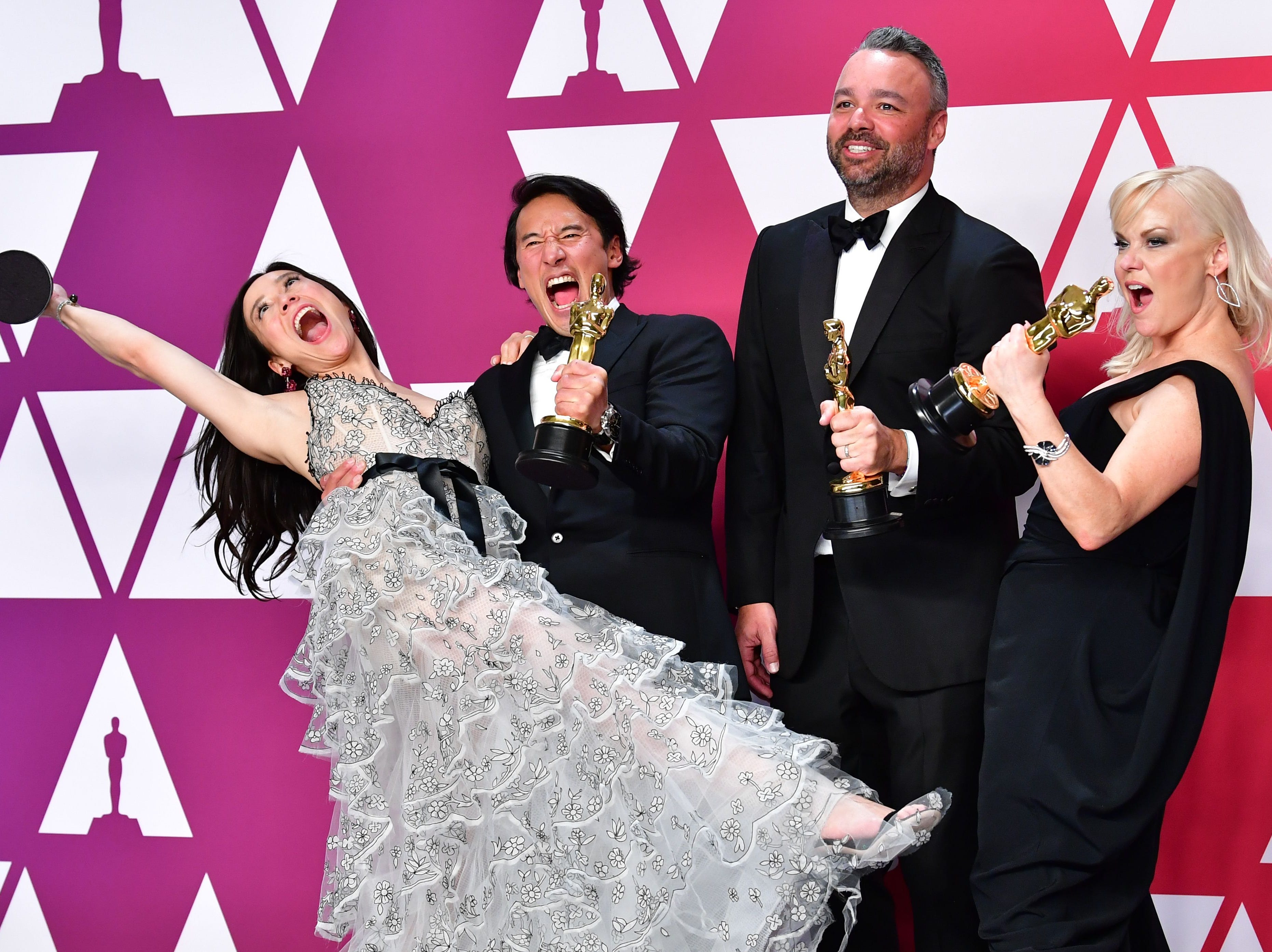"Best Documentary winners for ""Free Solo"" Elizabeth Chai Vasarhelyi, Jimmy Chin, Evan Hayes and Shannon Dill pose in the press room during the 91st Annual Academy Awards at the Dolby Theater in Hollywood, California on February 24, 2019."