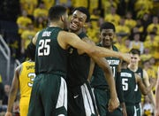 Michigan State's Kenny Goins, Xavier Tillman and Aaron Henry begin to celebrate as the clock ticks down to a 77-70 Spartans' victory.