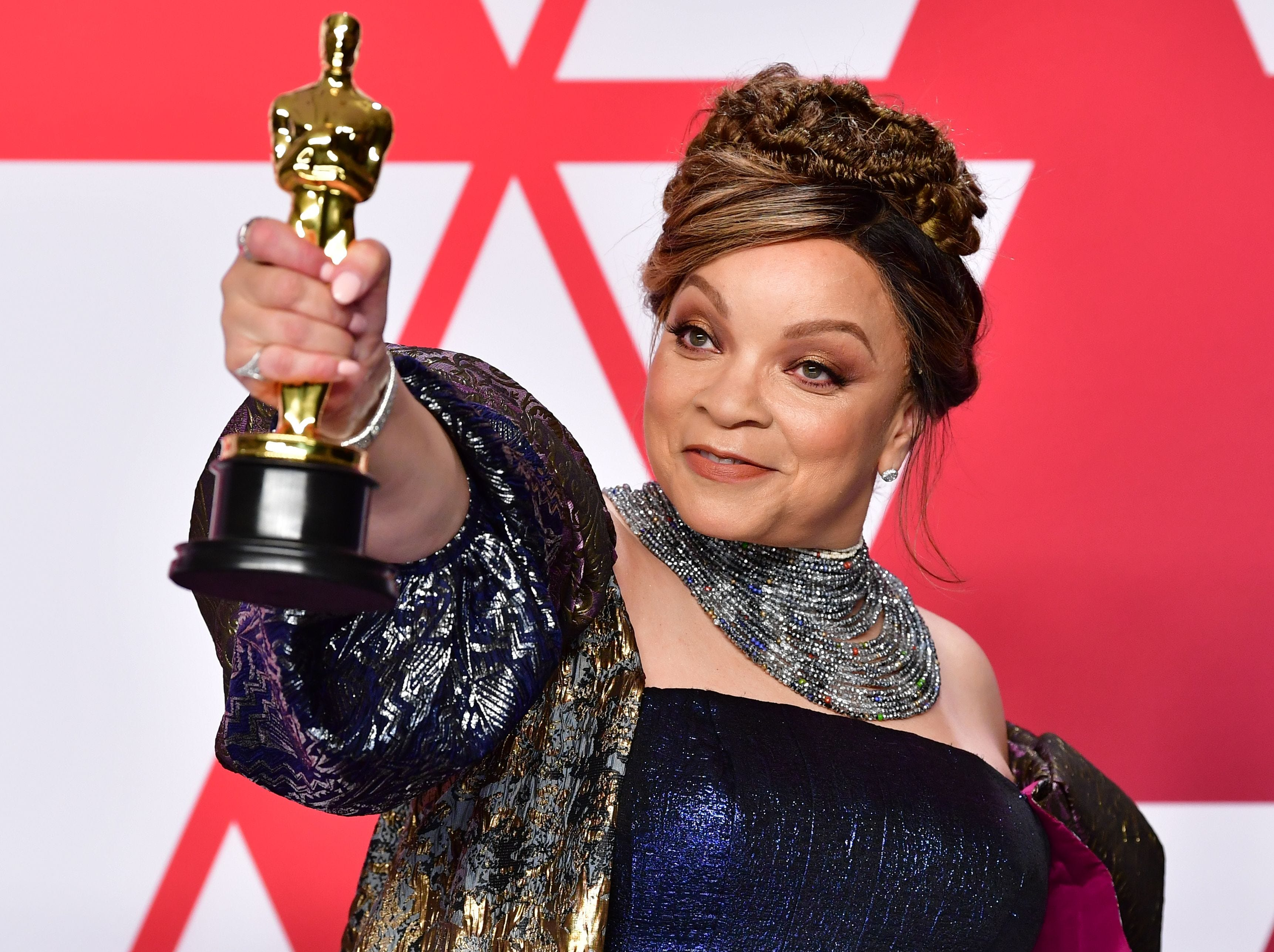 "Best Costume Design winner for ""Black Panther"" Ruth E. Carter poses in the press room with the Oscar."