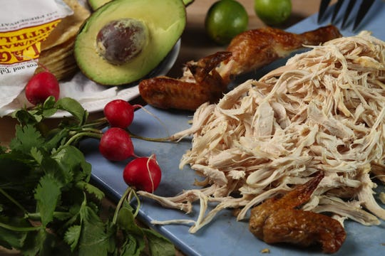 Depending on the size of the chicken, you should get about 4 cups of shredded meat. Deboning the bird and shredding the meat while the chicken is still warm makes the task easier. (Abel Uribe/Chicago Tribune/TNS)